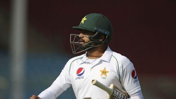 Pakistani captain Azhar Ali walks on his way to pavilion after being bowled by Sri Lankan Vishwa Fernando during the second Test in Karachi, Pakistan, Thursday, Dec. 19, 2019 - Sputnik International