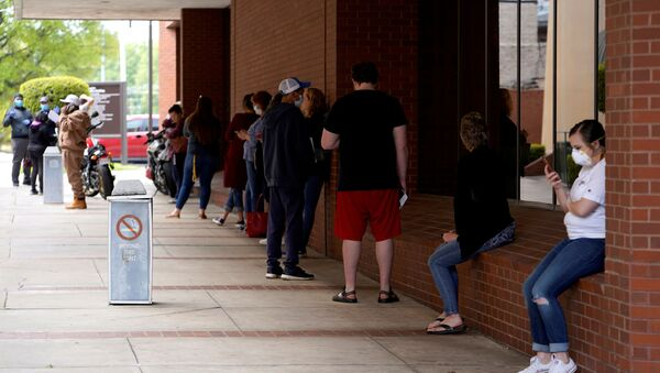 People who lost their jobs wait in line to file for unemployment following an outbreak of the coronavirus disease (COVID-19), at an Arkansas Workforce Center in Fort Smith, Arkansas, U.S. April 6, 2020 - Sputnik International