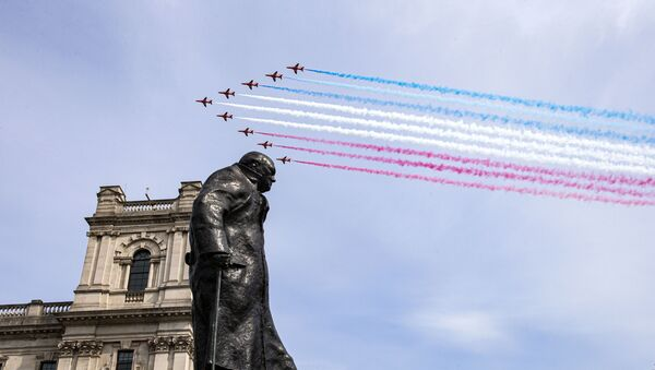 In a handout picture released by the British Ministry of Defence (MOD) on May 8, 2020, the Royal Air Force Red Arrows fly over the statue of Sir Winston Churchill to mark the 75th anniversary of VE Day (Victory in Europe Day), the end of the Second World War in Europe, in central London - Sputnik International