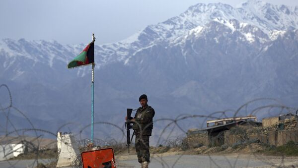 An Afghan National Army soldier stands guard at a checkpoint near the Bagram base north of Kabul, Afghanistan, Wednesday, April 8, 2020. An Afghan official said Wednesday that the country has released 100 Taliban prisoners from Bagram, claiming they are part of 5,000 detainees who are to be freed under a deal between insurgents and U.S. But the Taliban says they have yet to verify those released were on the list they had handed over to Washington during negotiations. - Sputnik International