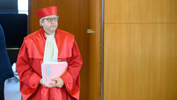The chairman of the German constitutional court AndreasVosskuhle arrives on May 5, 2020 at the Constitutional court in Karlsruhe, to give out the court's ruling that the European Central Bank must clarify a key bond-buying scheme to support the eurozone economy is proportionate or else Germany's Bundesbank central bank may no longer participate.  - Sputnik International