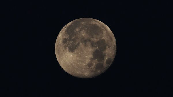 The moon hovers over in Mexico City, Friday, May 8, 2020. Mexico woke up to news of its largest one-day increase in confirmed cases of COVID-19, from Wednesday to Thursday - Sputnik International