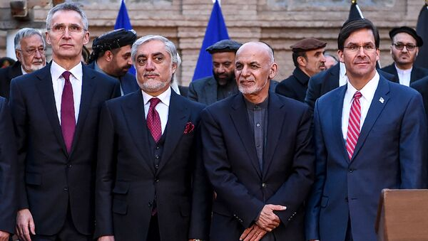 NATO Secretary General Jens Stoltenberg (L) pose along with Afghan presidential election opposition candidate Abdullah Abdullah (2L), Afghanistan's President Ashraf Ghani (2R) and US Secretary of Defense Mark Esper (R) after a press conference at the presidential palace in Kabul on February 29, 2020. - Sputnik International
