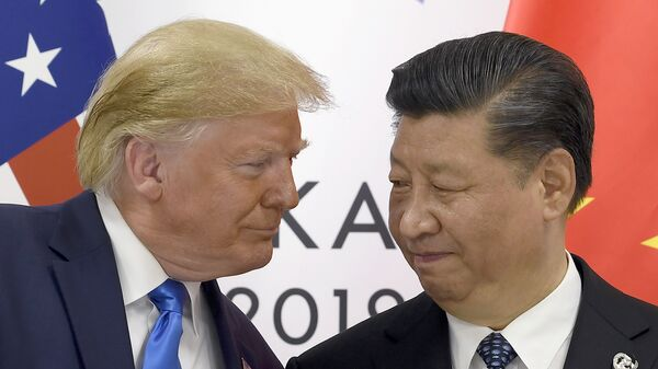 In this June 29, 2019, file photo, President Donald Trump, left, meets with Chinese President Xi Jinping during a meeting on the sidelines of the G-20 summit in Osaka, Japan. - Sputnik International