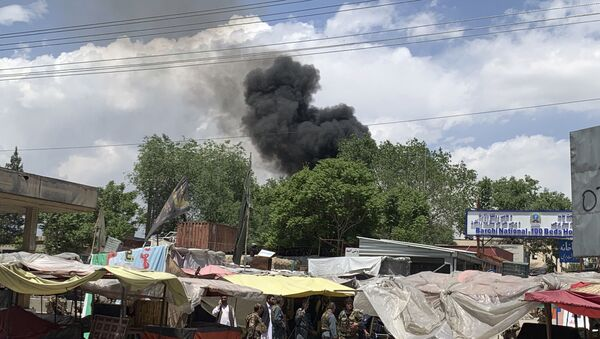 Smokes rises from a hospital after a gunmen attacked in Kabul, Afghanistan, Tuesday, May 12, 2020 - Sputnik International