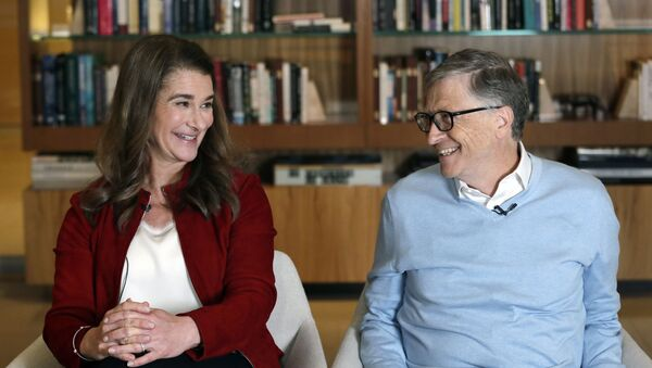 In this Feb. 1, 2019, Bill and Melinda Gates look toward each other and smile while being interviewed in Kirkland, Wash. The couple, whose foundation has the largest endowment in the world, are pushing back against a new wave of criticism about whether billionaire philanthropy is a force for good - Sputnik International