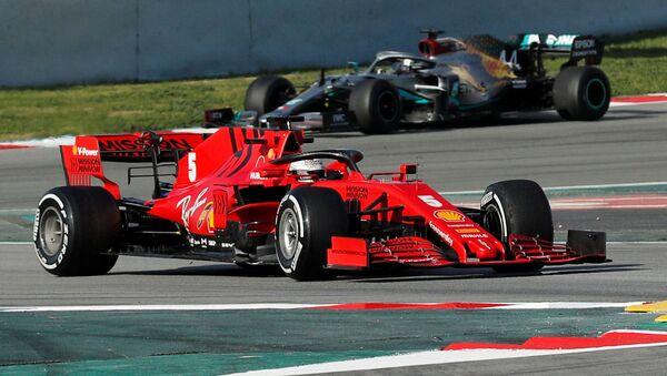 FILE PHOTO: Formula One F1 - Pre Season Testing - Circuit de Barcelona-Catalunya, Barcelona, Spain - February 26, 2020 Ferrari's Sebastian Vettel and Mercedes' Lewis Hamilton during testing - Sputnik International
