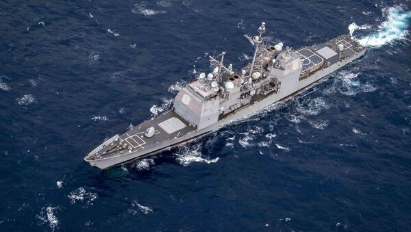 The guided-missile cruiser USS Philippine Sea (CG-58) transits the Atlantic Ocean as seen from a MH-60R Seahawk assigned to the guided-missile destroyer USS Gridley (DDG 101). Gridley is underway on a regularly-scheduled deployment as the flagship of Standing NATO Maritime Group 1 to conduct maritime operations and provide a continuous maritime capability for NATO in the northern Atlantic.  - Sputnik International
