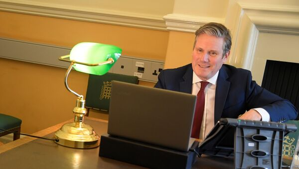 Britain's opposition Labour Party Leader Keir Starmer is seen in his office as he launches 'Call Keir' online public meetings, at the Houses of Parliament, following the outbreak of the coronavirus disease (COVID-19), in London, Britain, April 30, 2020 - Sputnik International