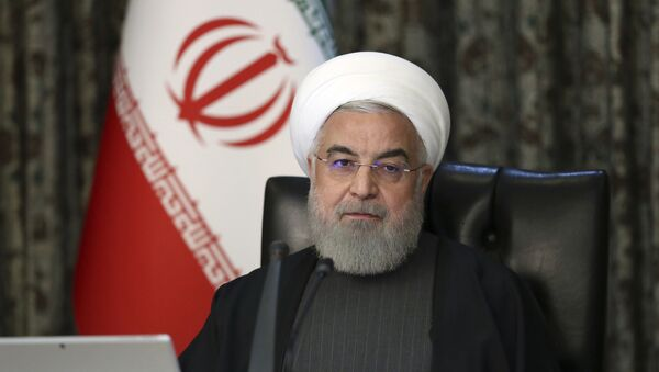 In this photo released by the official website of the Office of the Iranian Presidency, President Hassan Rouhani attends a cabinet meeting in Tehran, Iran. File photo. - Sputnik International