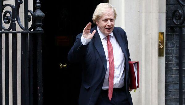 Britain's Prime Minister Boris Johnson leaves 10 Downing Street, following the outbreak of the coronavirus disease (COVID-19), London, Britain, May 11, 2020 - Sputnik International