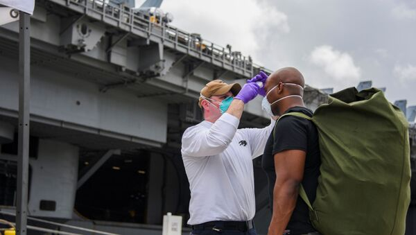U.S. Navy sailors assigned to aircraft carrier USS Theodore Roosevelt, who have tested negative twice for coronavirus disease (COVID-19), are asymptomatic and completed their off-ship quarantine or isolation, prepare to board the clean ship at Naval Base Guam May 1, 2020 - Sputnik International