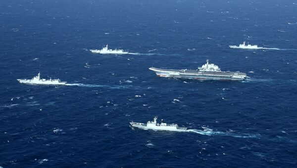 This aerial photo taken on January 2, 2017 shows a Chinese navy formation, including the aircraft carrier Liaoning (C), during military drills in the South China Sea - Sputnik International