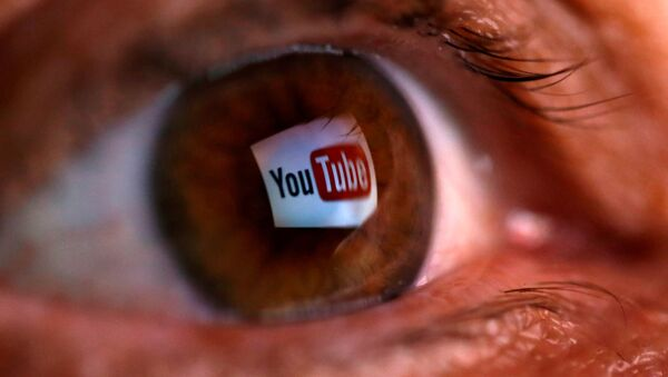 A picture illustration shows a YouTube logo reflected in a person's eye June 18, 2014 - Sputnik International