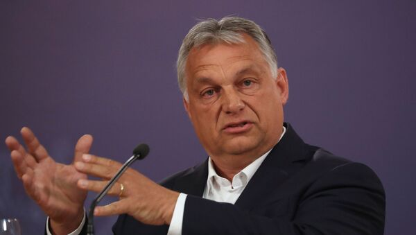 Hungarian Prime Minister Viktor Orban gestures during a news conference with Serbian President Aleksandar Vucic at the presidential building in Belgrade, following the coronavirus disease (COVID-19) outbreak, in Serbia, May 15, 2020 - Sputnik International