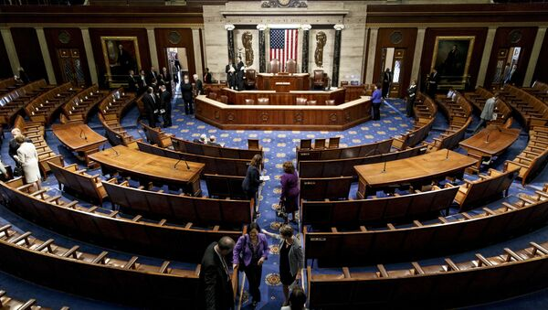The chamber of the House of Representatives empties following a joint meeting of Congress, at the Capitol in Washington, Thursday, Sept. 18, 2014, with visiting Ukranian President Petro Poroshenko. The House and Senate are wrapping up business and heading to their home states for the weeks leading up to the midterm elections - Sputnik International