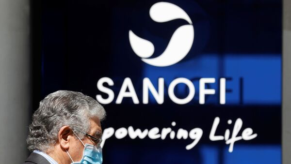 A man wearing a protective face mask walks past the logo of Sanofi at the company's headquarters in Paris, France, April 24, 2020. R - Sputnik International