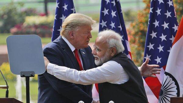 U.S. President Donald Trump and Indian Prime Minister Narendra Modi embrace after giving a joint statement in New Delhi, India, Tuesday, Feb. 25, 2020. - Sputnik International