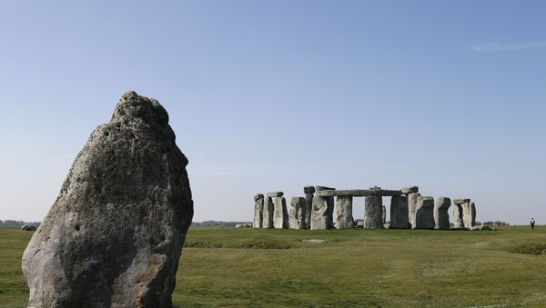 Security guards patrol the prehistoric monument at Stonehenge in southern England, on April 26, 2020, closed during the national lockdown due to the novel coronavirus COVID-19 pandemic - Sputnik International