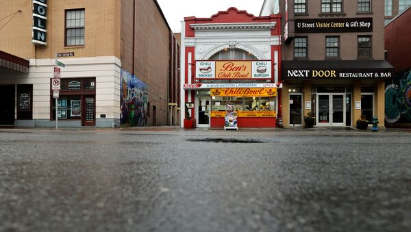 The sidewalk is seen empty during dinner hour at Ben's Chili Bowl, whose founders Ben and Virginia Ali famously kept the restaurant running through very difficult times in the past, as the eatery navigates the coronavirus disease (COVID-19) outbreak with no seating, limited hours and help from a federal Payroll Protection Program Loan in Washington, U.S. April 30, 2020. - Sputnik International