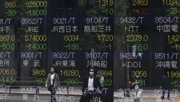 Pedestrians are seen reflected in a quotation board displaying stock prices on the Tokyo Stock Exchange in Tokyo on May 7, 2020. - Sputnik International