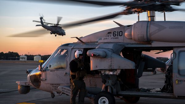 A U.S. Navy MH-60S Seahawk aircrew member, assigned to the Helicopter Sea Combat Squadron 14, prepares for a close air support training scenario during Southern Strike 2020 at the Gulfport Combat Readiness Training Center, Miss., Feb. 2, 2020 - Sputnik International