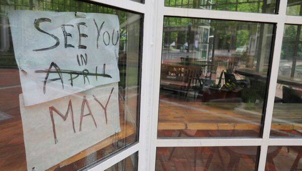 The sign on Sip Cafe reads See you in May, with April crossed out, amid the coronavirus disease (COVID-19) outbreak in Boston, Massachusetts, U.S., May 18, 2020.    - Sputnik International