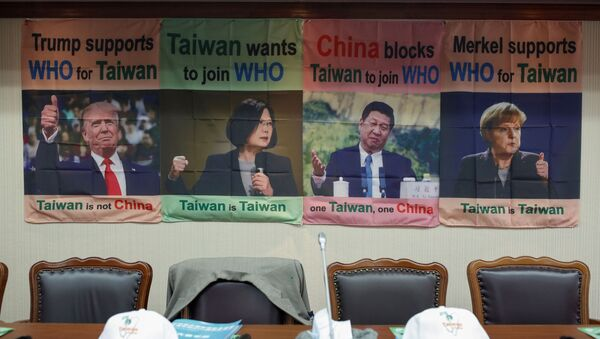 A banner with pictures of world leaders is seen before Taiwan's Health Minister Chen Shih-chung news conference about Taiwan's efforts to get into the World Health Organisation in Taipei, Taiwan, May 15, 2020. - Sputnik International