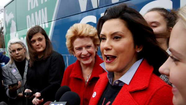 Michigan Democratic gubernatorial candidate Gretchen Whitmer with U.S. Sen. Debbie Stabenow talk to reporters with U.S. arrives to vote in midterm election at her polling station at the St. Paul Lutheran Church in East Lansing, Michigan, U.S. November 6, 2018. - Sputnik International