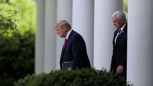 U.S. President Donald Trump is followed by Vice President Mike Pence as he arrives to discuss the administration's coronavirus response at a news conference in the Rose Garden at the White House in Washington, U.S., April 27, 2020. - Sputnik International