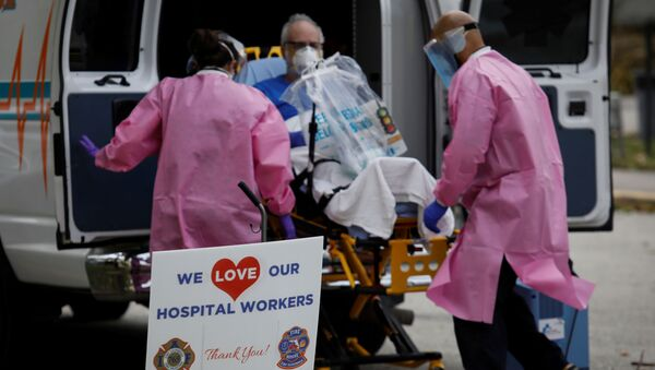 A sign thanking hospital workers is seen outside the ER area at Holy Cross Hospital, amid an outbreak of coronavirus disease (COVID-19), in Fort Lauderdale, Florida, U.S., April 20, 2020. - Sputnik International