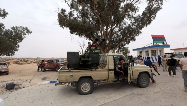 Fighters loyal to Libya's internationally recognised government are seen after taking control of Watiya airbase, southwest of Tripoli, Libya May 18, 2020.  - Sputnik International