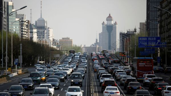 Cars are seen in a traffic jam during evening rush hour in Beijing, as the country is hit by an outbreak of the novel coronavirus (COVID-19), China April 8, 2020. - Sputnik International