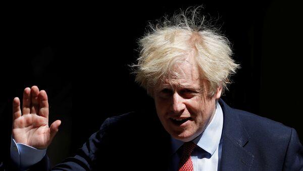 Britain's Prime Minister Boris Johnson in Downing Street following the outbreak of the coronavirus disease (COVID-19), London, Britain, May 20, 2020. - Sputnik International