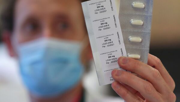 A pharmacy worker shows pills of hydroxychloroquine used to treat the coronavirus disease (COVID-19) at the CHR Centre Hospitalier Regional de la Citadelle Hospital in Liege, Belgium, April 22, 2020 - Sputnik International