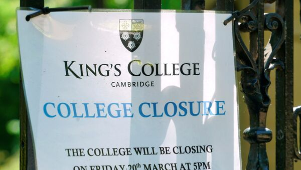 A sign at Kings College Cambridge, announcing its March closure, is displayed on the university's gates amid the novel coronavirus outbreak, in Cambridge, Britain May 20, 2020 - Sputnik International