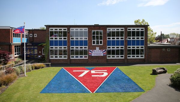General view of a painting to commemorate the 75th anniversary of VE Day painted by staff of Barnton Primary School, following the outbreak of the coronavirus disease (COVID-19), Barnton, Britain, May 7, 2020. REUTERS/Molly Darlington - Sputnik International