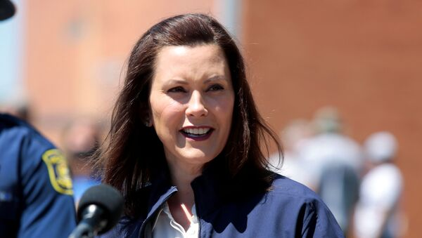 Michigan Governor Gretchen Whitmer addresses the media about the flooding along the Tittabawassee River, after several dams breached, in downtown Midland, Michigan, U.S., May 20, 2020.  - Sputnik International