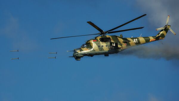 Mi-24 helicopter fires at targets during the joint Russian-Belarusian operational exercise Union Shield 2015 at a military range in Kamenka, Leningrad Region - Sputnik International