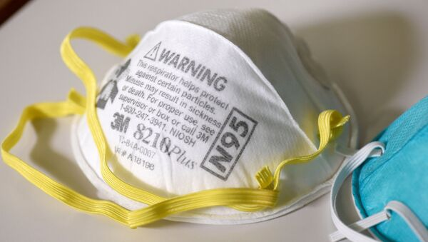 Various N95 respiration masks at a laboratory of 3M, which has been contracted by the U.S. government to produce extra masks in response to the country's novel coronavirus outbreak, in Maplewood, Minnesota, U.S. March 4, 2020 - Sputnik International