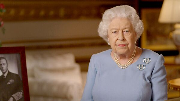 Britain's Queen Elizabeth II delivers an address to the nation and the Commonwealth on the 75th anniversary of VE Day at Windsor Castle, Britain, in this Buckingham Palace handout image released May 8, 2020 - Sputnik International