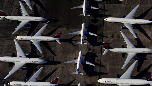 Delta Air Lines passenger planes are seen parked due to flight reductions made to slow the spread of coronavirus disease (COVID-19), at Birmingham-Shuttlesworth International Airport in Birmingham, Alabama, 25 March 2020 - Sputnik International