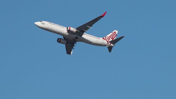 A Virgin Australia Airlines plane takes off from Kingsford Smith International Airport in Sydney, Australia, March 18, 2020 - Sputnik International