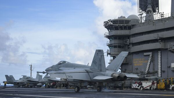 """An F/A-18E Super Hornet, assigned to the """"Blue Diamonds"""" of Strike Fighter Squadron (VFA) 146, lands on the flight deck of the aircraft carrier USS Theodore Roosevelt (CVN 71) May 25, 2020 - Sputnik International"""