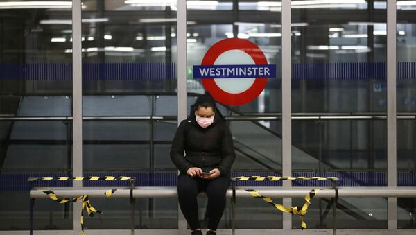 A woman wearing a protective face mask is seen at Westminster tube station, following the outbreak of the coronavirus disease (COVID-19), London, Britain, May 11, 2020. - Sputnik International