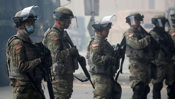 National Guard members guard the area in the aftermath of a protest after a white police officer was caught on a bystander's video pressing his knee into the neck of African-American man George Floyd, who later died at a hospital. File photo  - Sputnik International