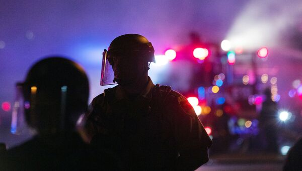 Minneapolis Police Department officers watch protesters during continued demonstrations against the death in Minneapolis police custody of African-American man George Floyd, in Minneapolis, Minnesota, 30 May 2020 - Sputnik International