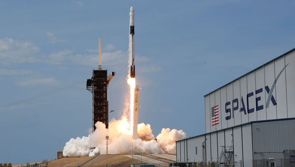 A SpaceX Falcon 9 rocket and Crew Dragon spacecraft carrying NASA astronauts Douglas Hurley and Robert Behnken lifts off during NASA's SpaceX Demo-2 mission to the International Space Station from NASA's Kennedy Space Center in Cape Canaveral, Florida, U.S., May 30, 2020 - Sputnik International
