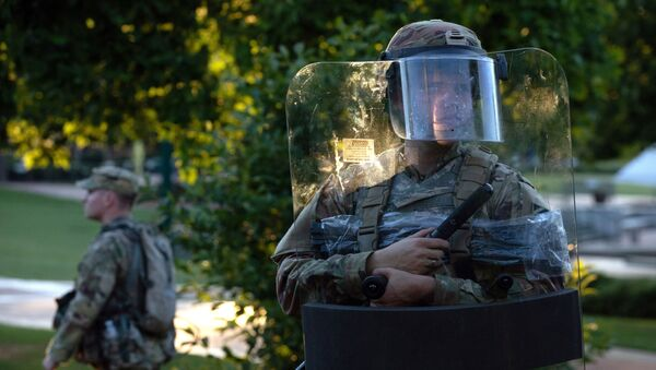 The National Guard protected a barricaded Centennial Olympic Park in Downtown Atlanta during a protest against the death in Minneapolis police custody of African-American man George Floyd, in Atlanta, Georgia, U.S. May 30, 2020 - Sputnik International