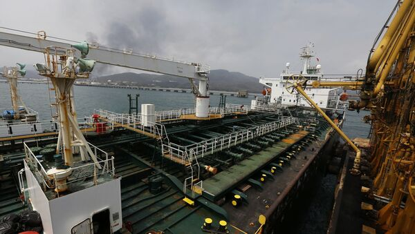 Iranian oil tanker Fortune is anchored at the dock of the El Palito refinery near Puerto Cabello, Venezuela, Monday, May 25, 2020 - Sputnik International